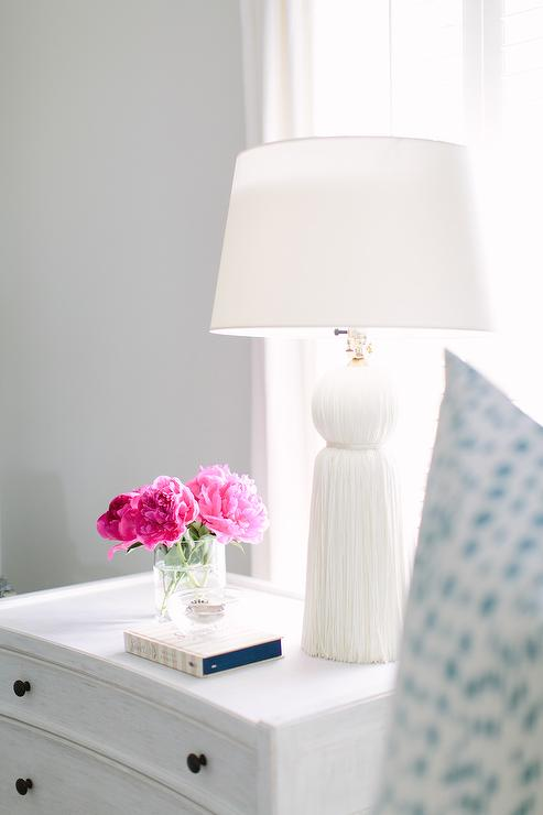 Whitewashed nightstand with arteriors tassel lamp for Bedroom nightstand lamps