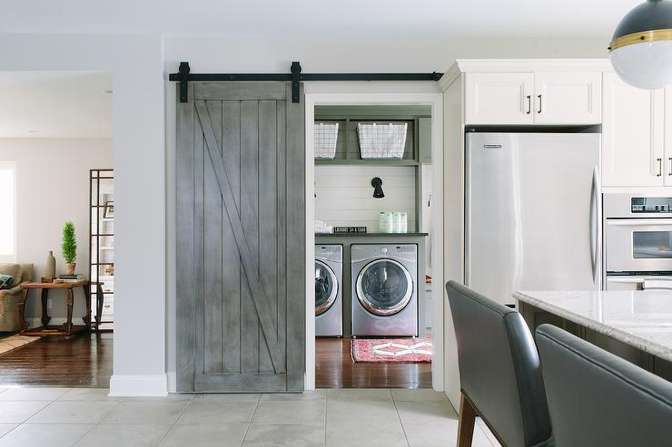 Laundry Room with Gray Barn Door on Rails Cottage Laundry Room