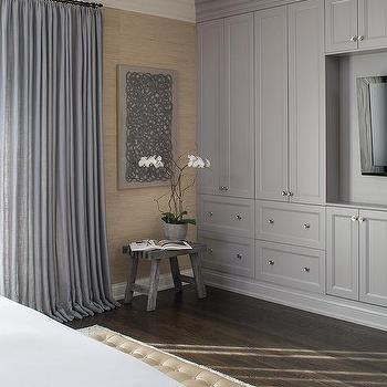 master bedroom with gray built in cabinets