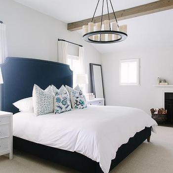 White And Navy Bedroom With Fireplace
