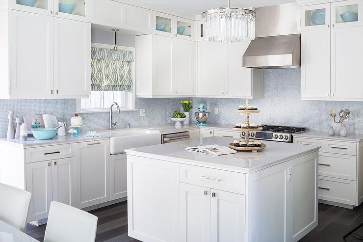 white kitchen with blue mosaic tile backsplash