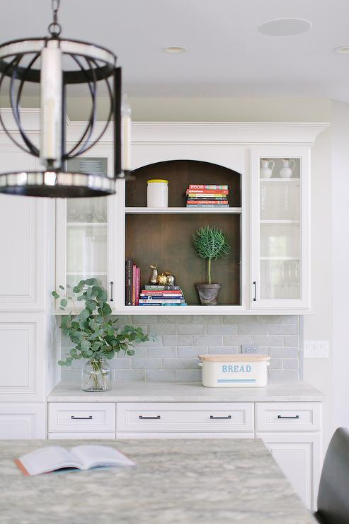 White Kitchen Cabinets With Blue Beveled Subway Tiles