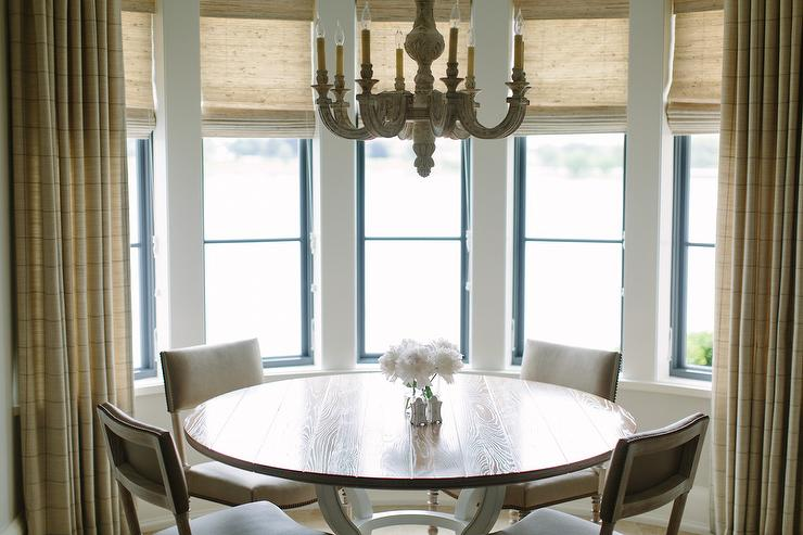 round dining table with gray dining chairs - transitional - dining
