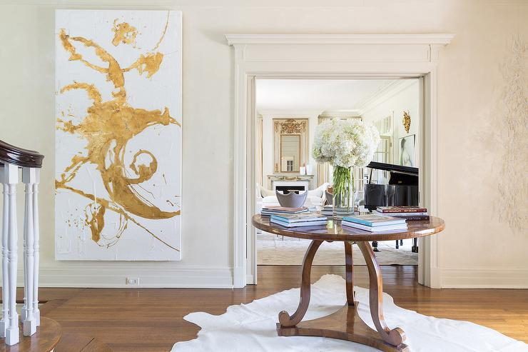 Large Foyer Table Round : Round foyer table with large gold abstract art