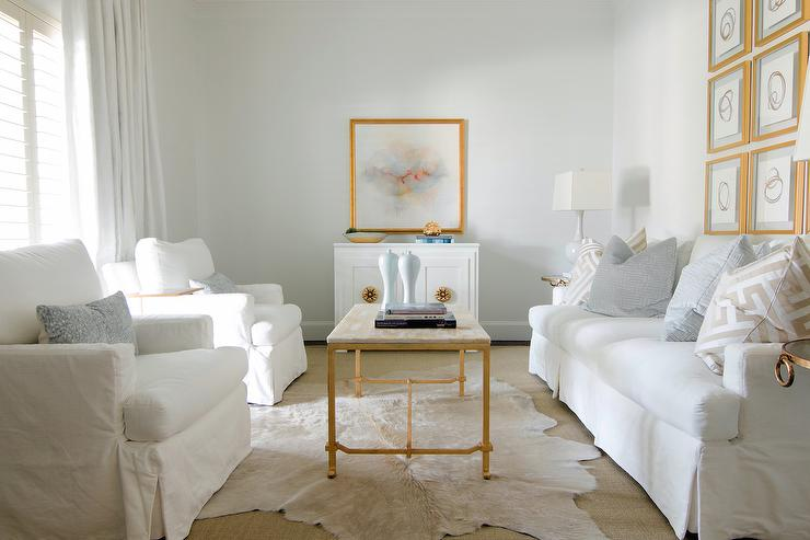 Marble And Gold Leaf Cocktail Table Atop Layered Rugs Transitional Living Room