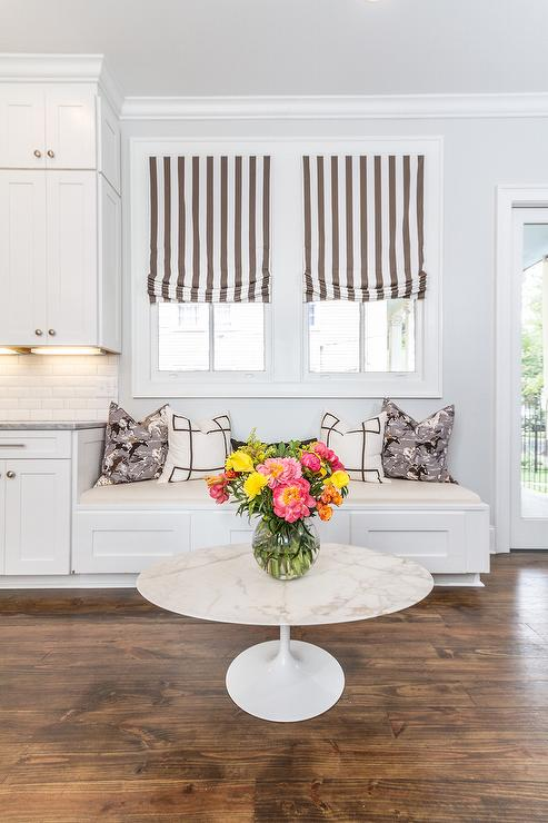 Glam Kitchen Features A Built In Window Seat Lined With Black And White  Greek Key Pillows And Gray Horse Pillows Placed Under Windows Dressed In  White And ...