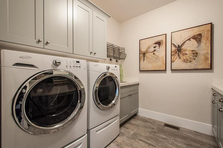 wood like floor tiles in laundry room transitional laundry room