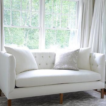 White and Grey Bedroom with White Tufted Sofa. Sofa In Front Of Window Design Ideas