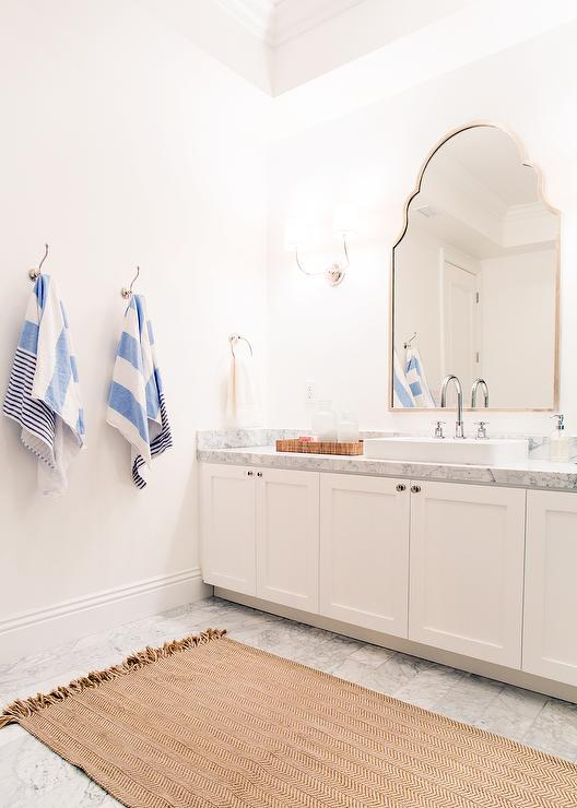 'view full size' from the web at 'https://cdn.decorpad.com/photos/2015/09/19/pottery-barn-chevron-recycled-yarn-indoor-outdoor-rug-arched-vanity-mirror.jpg'