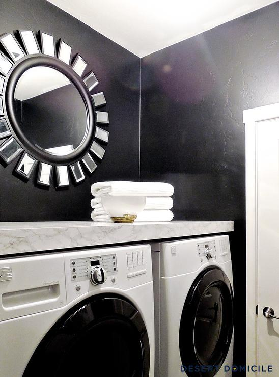 Black And White Laundry Room With Floating Shelf