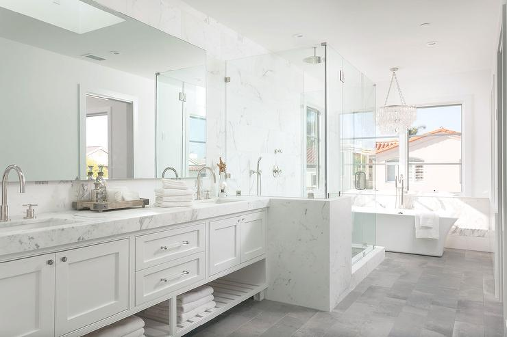 White master bathroom with gray tiled floors for Master bathroom white
