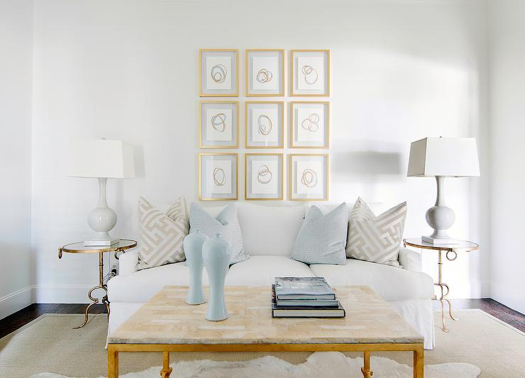 White skirted sofa with round brass and mirror end tables transitional living room for White end tables for living room