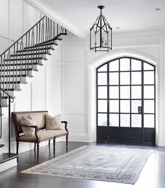 Foyer With Floor To Ceiling Wainscoting