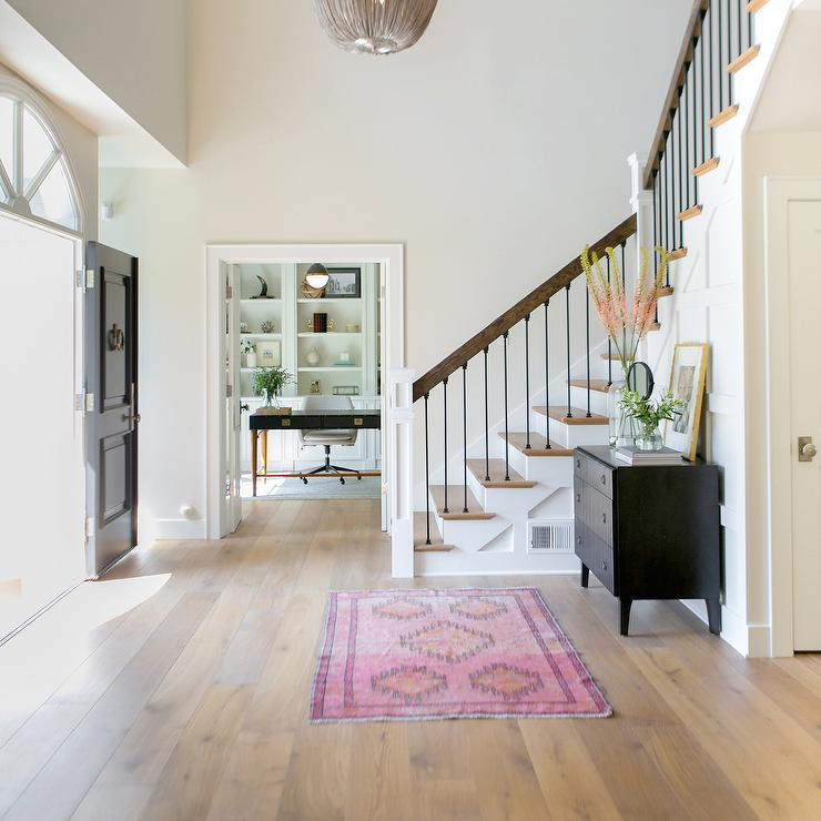 Foyer Rug : Spacious foyer with black chest and pink rug