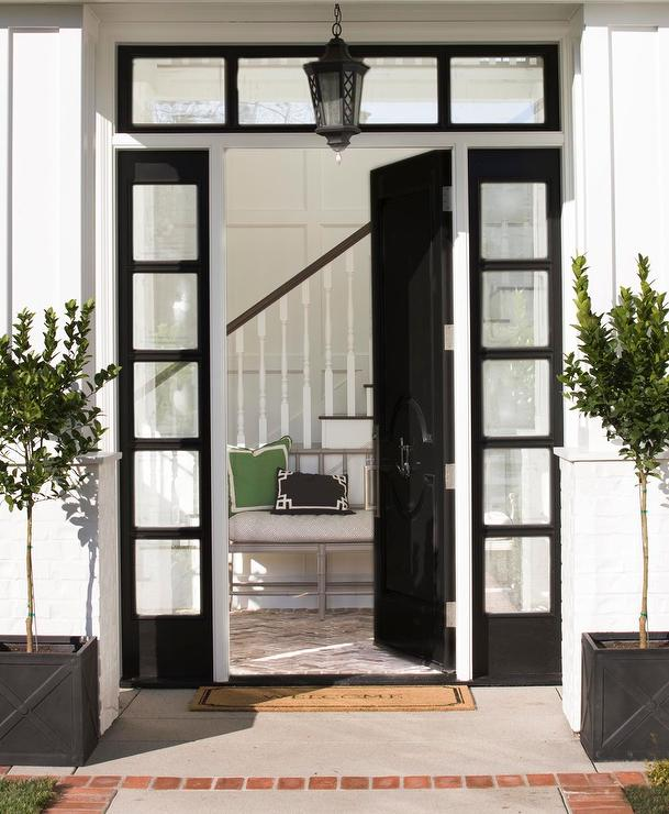 Glossy Black Front Door With Black Sidelights Transitional Home