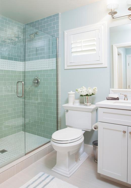 Blue cottage bathroom with blue subway shower tiles for Small bathroom design cottage