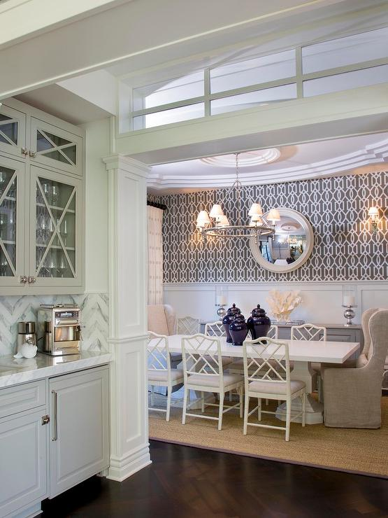 white and grey dining room with white bamboo chairs