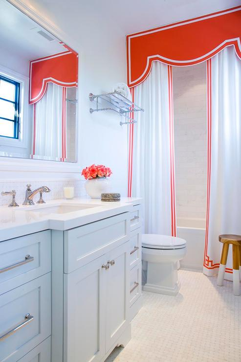 shower with red valance and greek key shower curtains