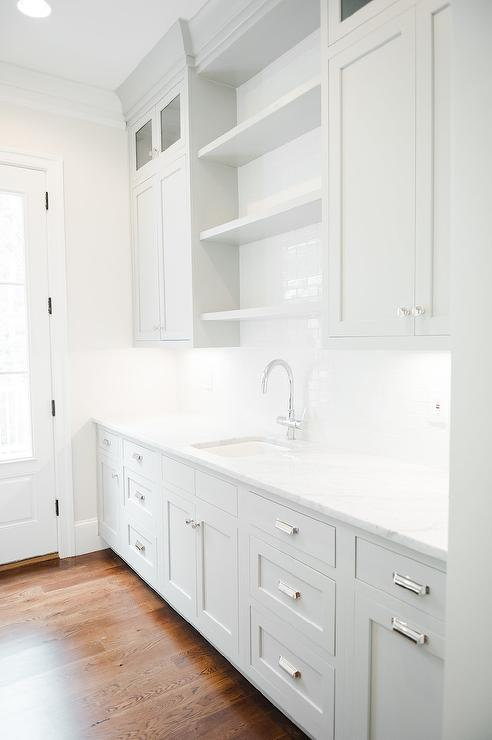 Grey Butler Pantry Cabinets With White Marble Countertops