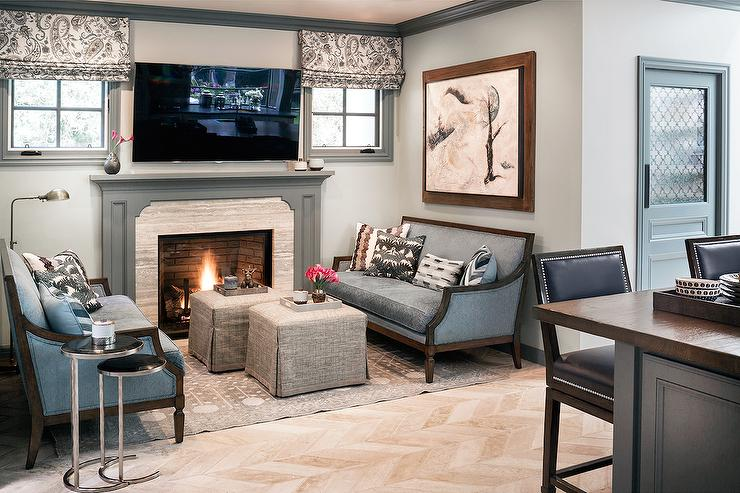 Chic Grey Family Room Features Walls Painted Gray Green Finished With Gray  Crown Moldings And Base Boards Lined With A Gray Fireplace Mantle And A  Tilted ...