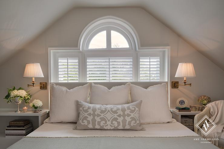 Gray headboard in front of shutter windows traditional bedroom Master bedroom bed against window