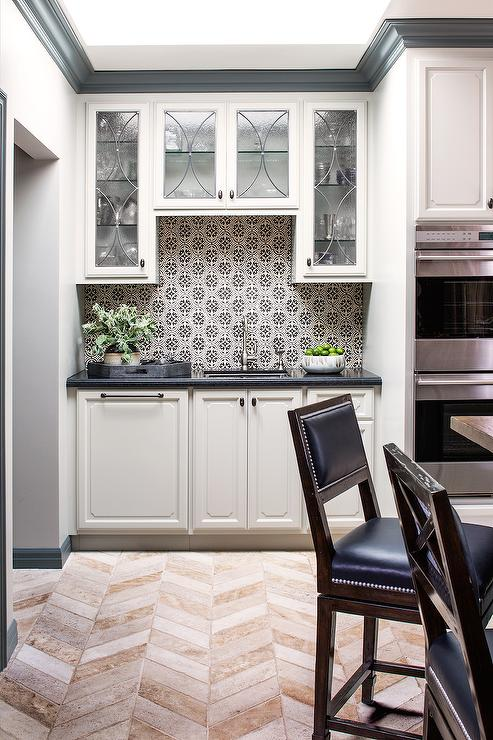 Beautiful Kitchen Features Leaded Glass Upper Cabinets And White Lower  Cabinets Paired With Black Granite Countertops And A Black And White Mosaic  Tile ...