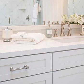 'White Shaker Vanity Cabinets with Gray Glass Tile Backsplash' from the web at 'https://cdn.decorpad.com/photos/2015/09/25/m_white-shaker-vanity-cabinets-linear-gray-glass-tile-backsplash.jpg'