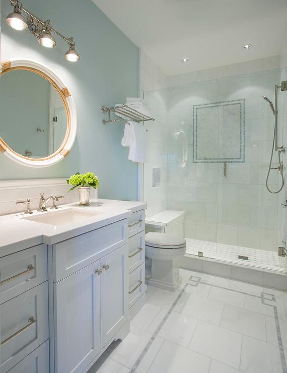 white and blue bathroom with greek key floor tiles - transitional