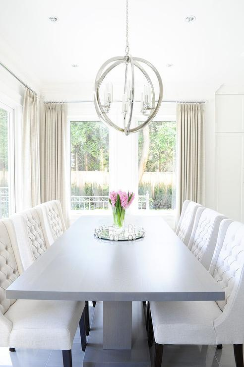 Gray Pedestal Dining Table With White Tufted Dining Chairs View Full Size