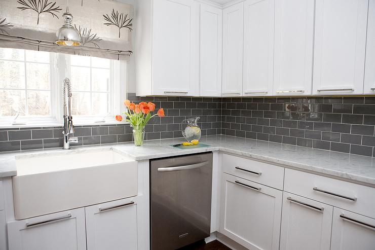 White kitchen cabinets with gray subway tile backsplash for Subway vigo