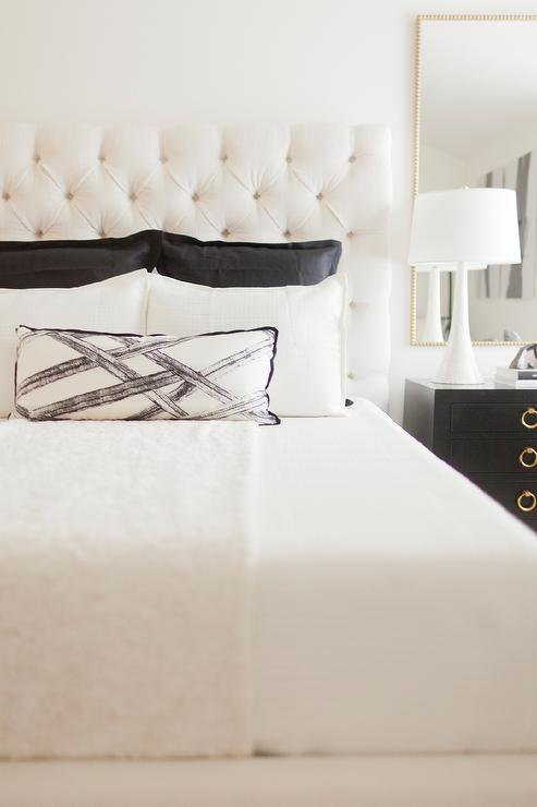 White Tufted Headboard With Black Nightstand