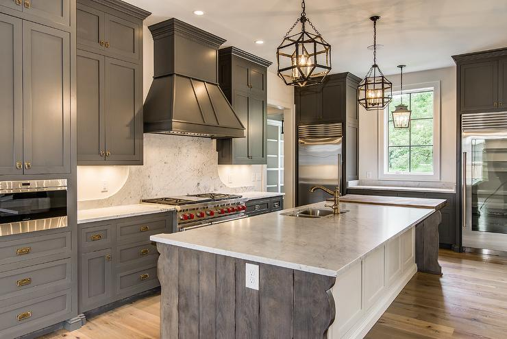 Gray Shaker Cabinets with White Kitchen Island
