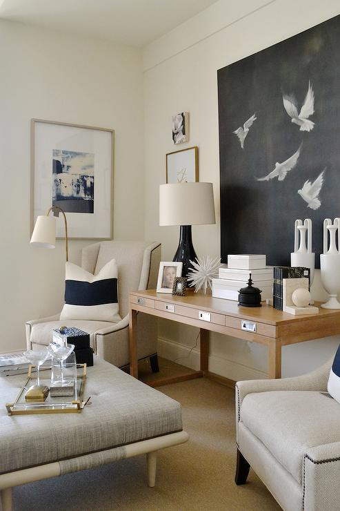 Chic Living Room Features A 4 Drawer Console Table Under A Black And White  Canvas Art Piece Flanked By Ivory Nailhead Wingback Chairs Lined With White  And ...