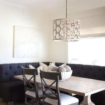 Black Tufted Dining Banquette With Reclaimed Wood Dining Table