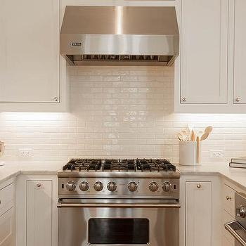 Stacked white kitchen cabinets with italian carrera marble Italian marble backsplash