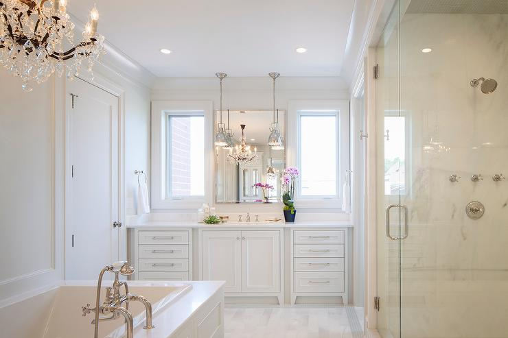 Bathroom Mirrors Over Windows all white master bathroom with chandelier over tub - transitional
