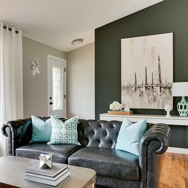 Black Leather Chesterfield Sofa With Turquoise Pillows Contemporary Kitchen
