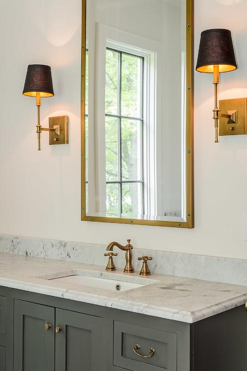 White And Gold Bathroom With Brass Rivet Medicine Cabinets