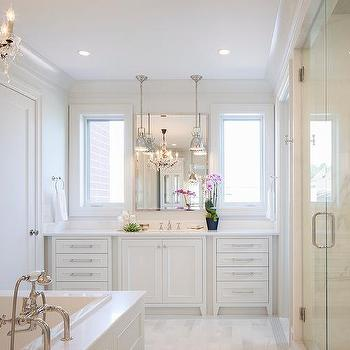 Bathroom vanity cabinets with antiqued mirrored doors for White master bathrooms