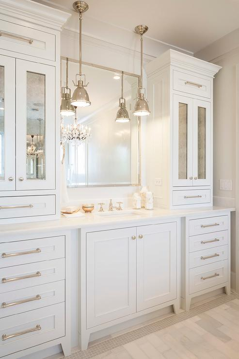 all white bathroom features an extra wide single vanity topped with