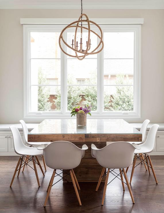 contemporary dining room features a rope sphere chandelier hanging over a square wood dining table with glass top lined with eames molded plastic armchairs - Square Wood Dining Table