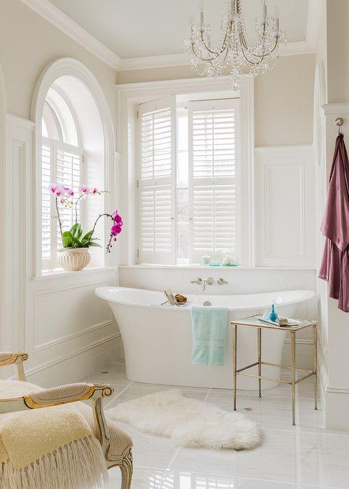 Oval Tub Under Plantation Shutter Windows Traditional Bathroom
