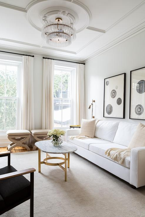 White Sofa with Oval Marble and Brass Coffee Table - Contemporary ...