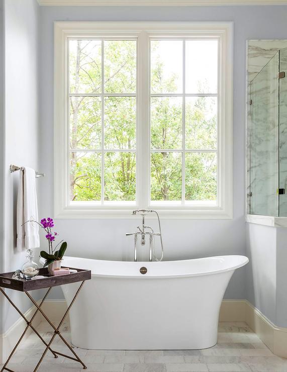 Blue Spa Like Bathroom With Freestanding Tub
