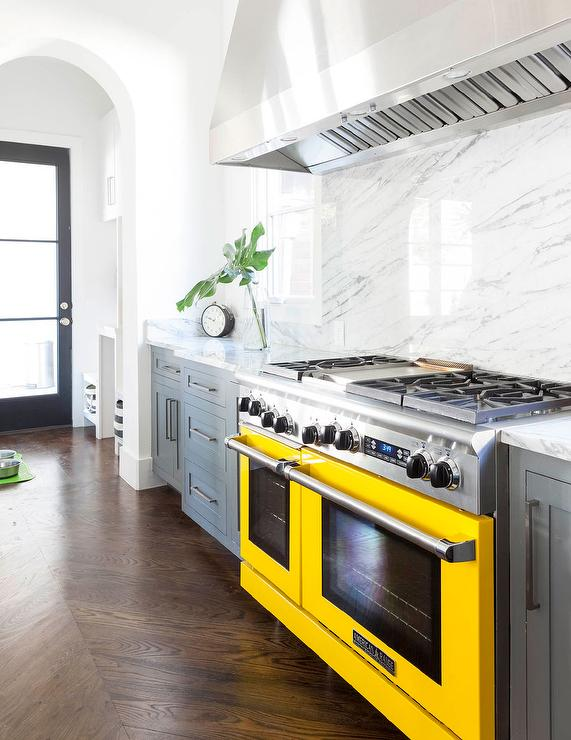 Gray kitchen cabinets with yellow stove contemporary for Grey yellow kitchen ideas