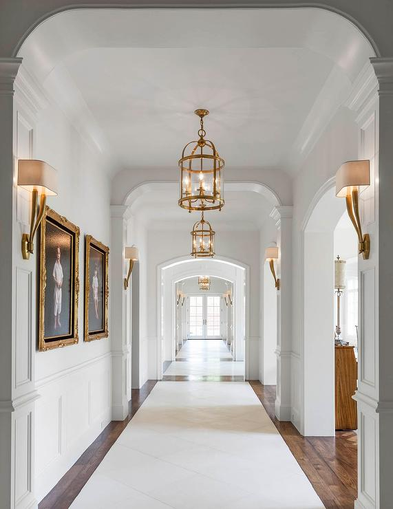 Long Hallway With Antique Brass Sconces And Lanterns