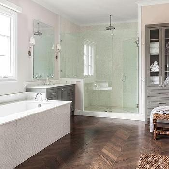 herringbone bathroom floor. White Mosaic Tiled Tub Between Gray Washstands Bathroom with Herringbone Pattern Floor  Transitional