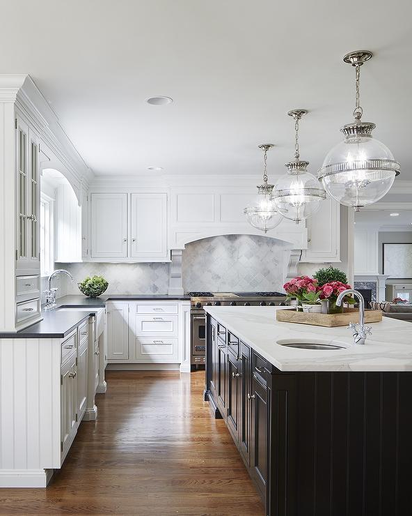 White cabinets with black island transitional kitchen for Dark kitchen cabinets light island