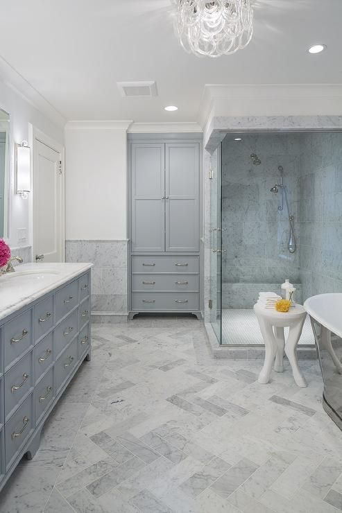 Great Honed Carrera Marble Herringbone Floor Tiles With Gray Recessed Linen  Cabinet
