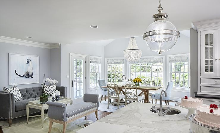 Grey And Blue Family Room Features Walls Painted Gray Benjamin Moore Shoreline Lined With A Tufted Sofa Silver Nailhead Trim